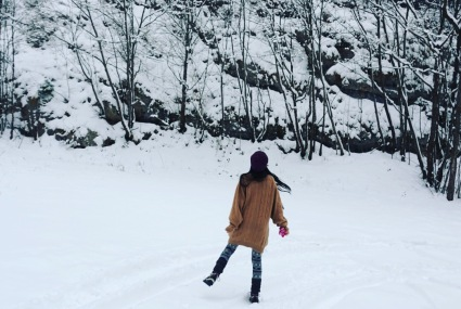 Little girl in a wild white snow world